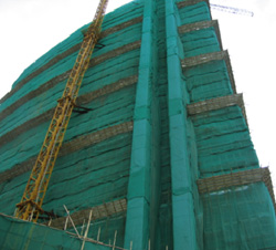 Dust screen for scaffolding and material hoist